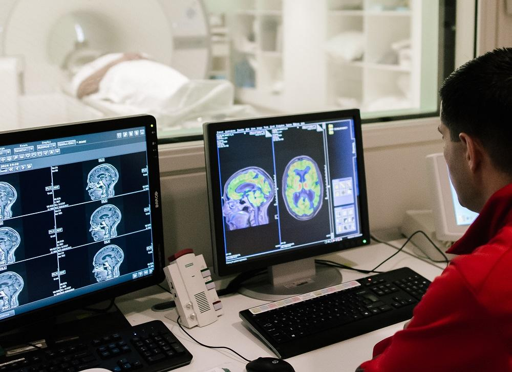 radiologist with scans